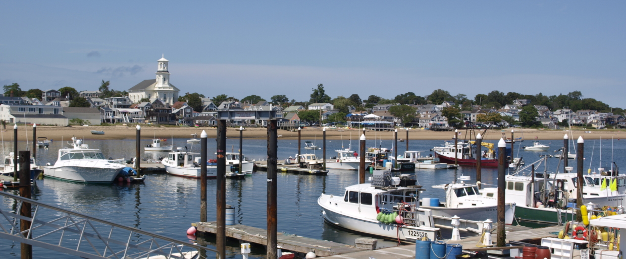 A summer day in a quaint fishing harbor in Wexford, RI